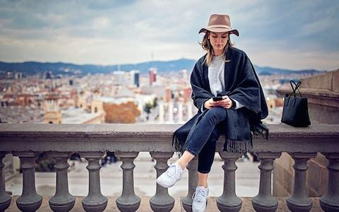 Being glued to your phone on holiday can enable a feeling of fomo - Credit: istock