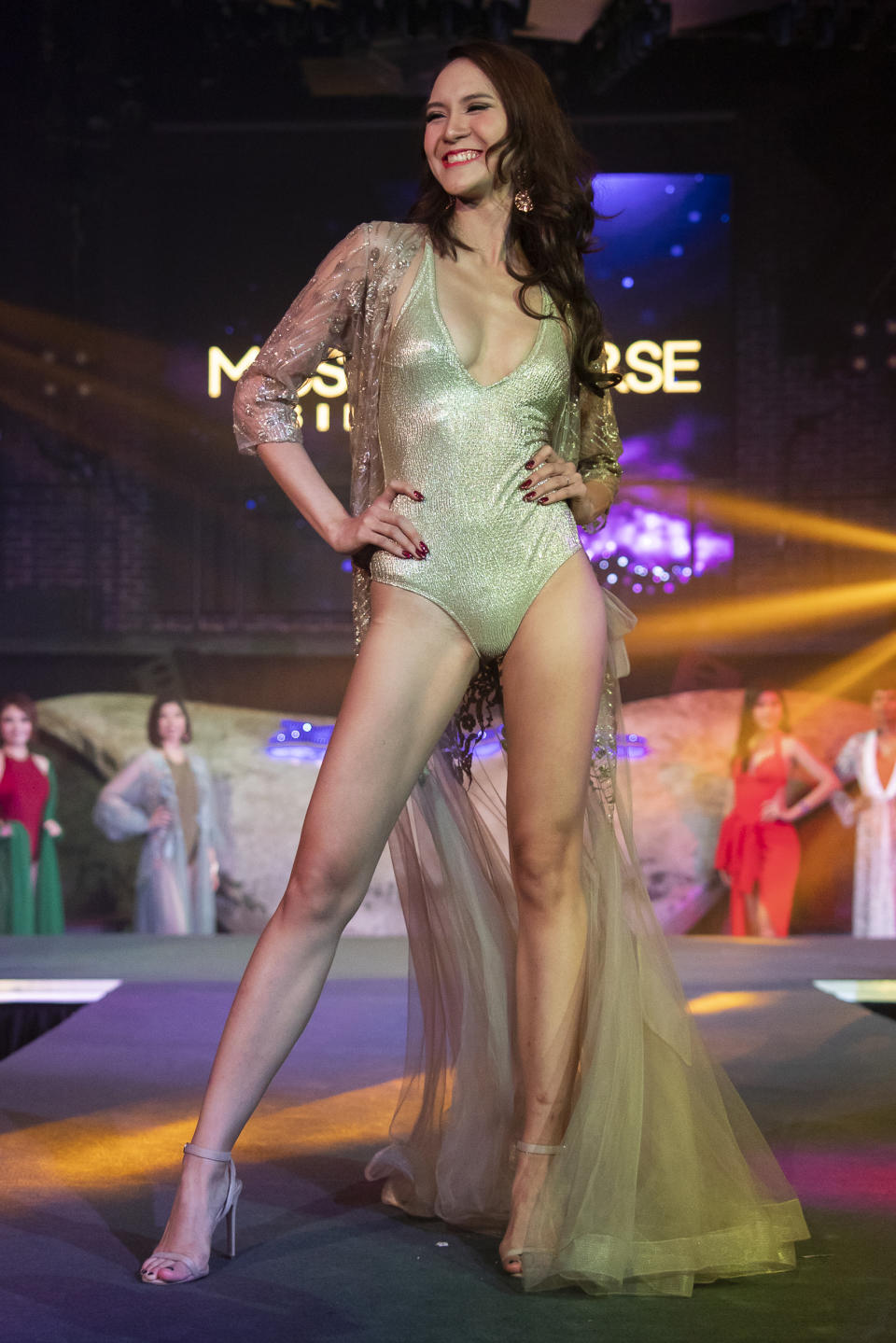 Valencia Quah competing in the swimwear segment during the 2019 Miss Universe Singapore at Zouk.