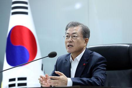 FILE PHOTO: South Korea's President Moon Jae-in speaks during a meeting with senior aides at the Blue House in Seoul