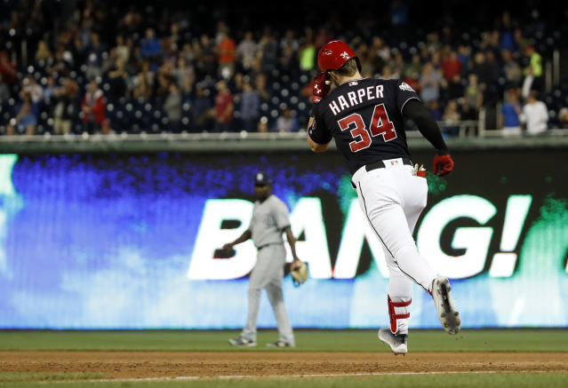 Washington Nationals' Bryce Harper rounds the bases on a solo home run during the fifth inning of a baseball game against San Diego Padres at Nationals Park, Tuesday, May 22, 2018, in Washington. (AP Photo/Alex Brandon)