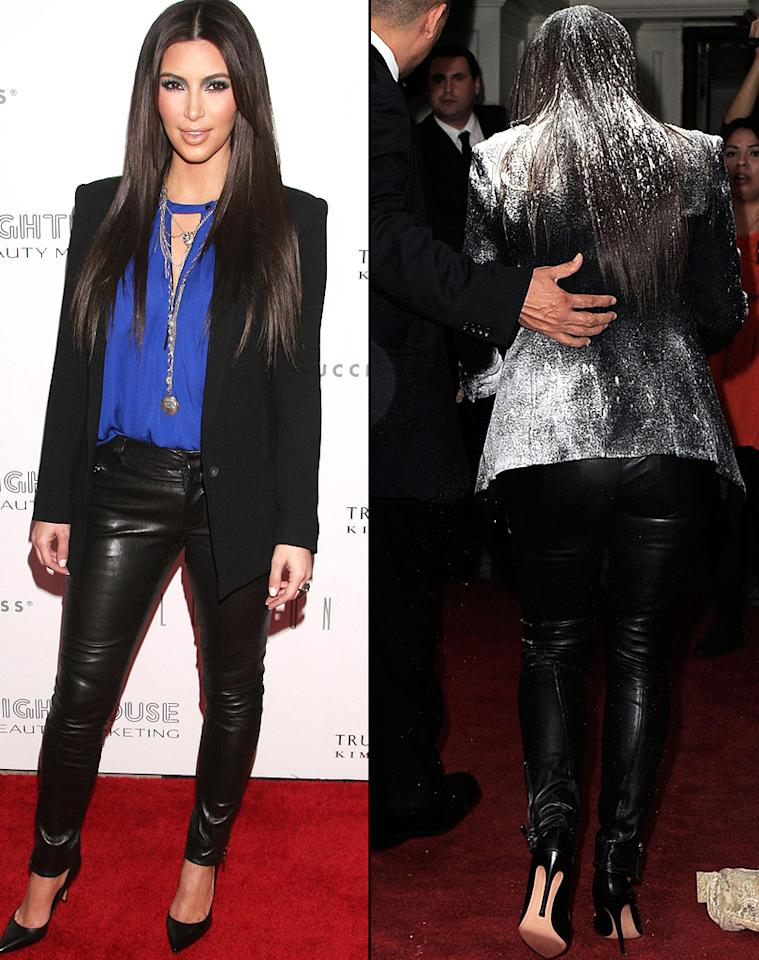 """While promoting her new fragrance at the London Hotel in West Hollywood, California, Thursday night, Kim Kardashian's perfect ensemble was temporarily ruined when she was showered with flour while walking the red carpet. The reality star was a surprisingly good sport about the whole ordeal, cleaning off her hair and blazer and even laughing about the incident. """"That probably is the craziest, unexpected, weird thing that ever happened to me,"""" she told E! online. """"Like I said to my makeup artist, I wanted more powder and that's a whole lot of translucent powder right there."""" Kardashian declined to press charges against the woman who threw the flour bomb, begging the question: Was this all a big publicity stunt? After all, she just got hundreds of media outlets to mention her new perfume. Hmm. (3/22/2012)"""