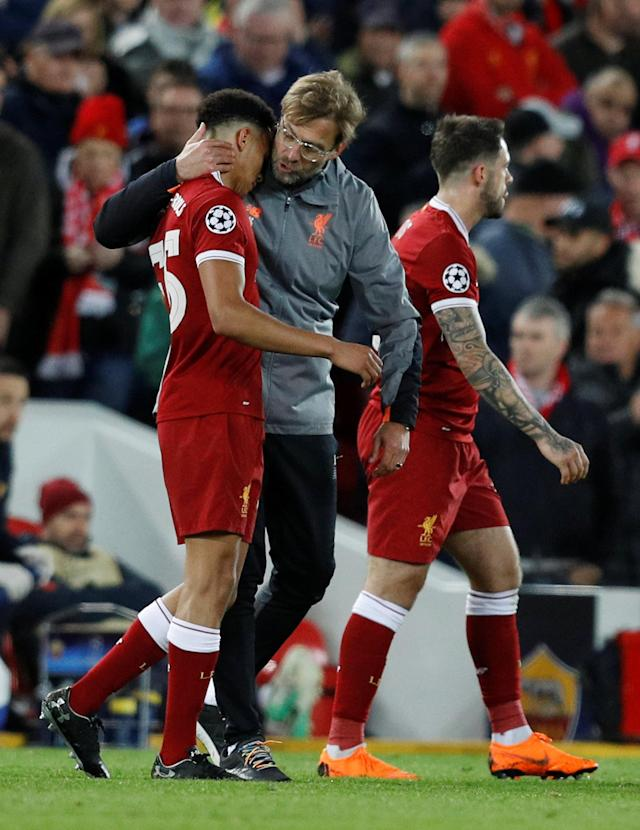 Soccer Football - Champions League Semi Final First Leg - Liverpool vs AS Roma - Anfield, Liverpool, Britain - April 24, 2018 Liverpool manager Juergen Klopp congratulates Trent Alexander-Arnold after the match REUTERS/Phil Noble