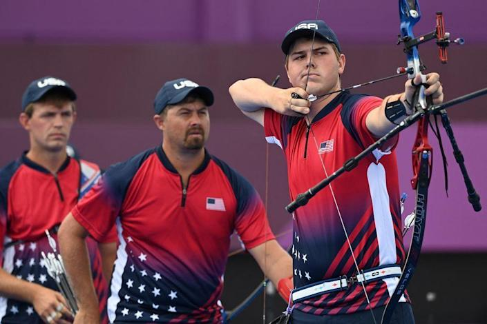 <p>USA's Jack Williams, Brady Ellison and Jacob Wukie compete in the men's team eliminations at Yumenoshima Park Archery Field. </p>