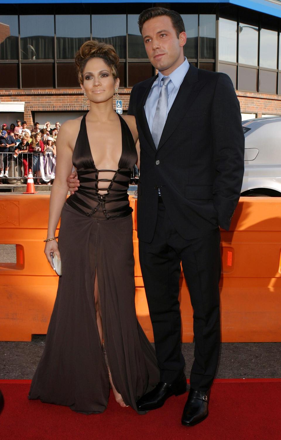 <p>Remember this? For the <strong>Gigli</strong> premiere in 2003, Jennifer showed off her curves in a brown Gucci gown, while Ben paired baby blue with his black suit.</p>