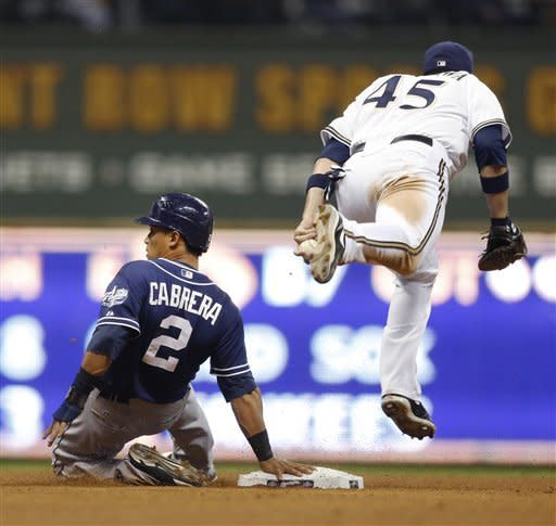 San Diego Padres' Everth Cabrera keeps a hand on second after being tagged out in a rundown between first and second base by Milwaukee Brewers' Travis Ishikawa during the fifth inning of a baseball game Tuesday, Oct. 2, 2012, in Milwaukee. (AP Photo/Tom Lynn)