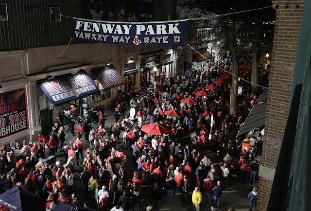 Fans make their way to Fenway Park before Game 1 of baseball's World Series between the Boston Red Sox and the St. Louis Cardinals Wednesday, Oct. 23, 2013, in Boston. (AP Photo/Charlie Riedel)