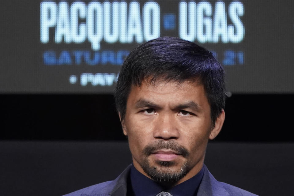 Manny Pacquiao, of the Philippines, attends a news conference Wednesday, Aug. 18, 2021, in Las Vegas. Pacquiao is scheduled to fight Yordenis Ugas, of Cuba, in a welterweight championship bout Saturday in Las Vegas. (AP Photo/John Locher)