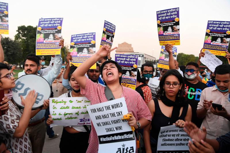 Demonstrators protest against Indian Police for allegedly cremating the body of a 19-year-old woman victim (AFP via Getty Images)