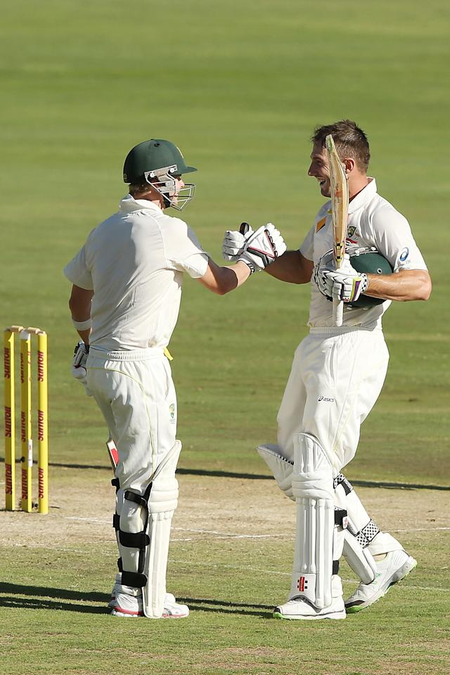CENTURION, SOUTH AFRICA - FEBRUARY 12: Shaun Marsh (R) of Australia celebrates reaching 100 runs during day one of the First Test match between South Africa and Australia on February 12, 2014 in Centurion, South Africa. (Photo by Morne de Klerk/Getty Images)