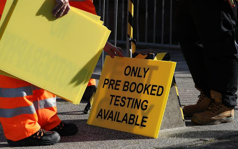 A sign is put up at the new walk-through testing centre at Glasgow Caledonian University - Getty Images Europe