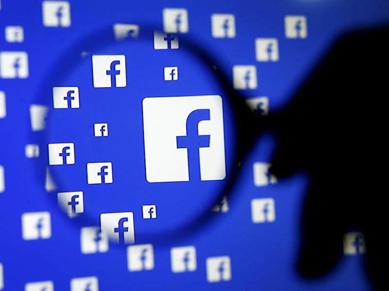 2015A man poses with a magnifier in front of a Facebook logo on display in this illustration taken in Sarajevo, Bosnia and Herzegovina, December 16, 2015: REUTERS/Dado Ruvic