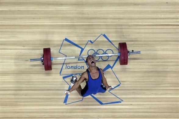 Micronesia's Manuel Minginfel drops weights on the men's 62Kg Group B weightlifting competition at the London 2012 Olympic Games July 30, 2012.