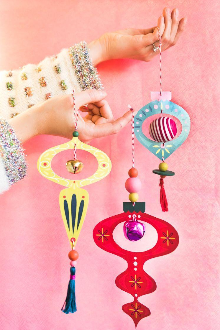 """<p>Wooden beads and embroidery floss bring these chic ornaments to life. They're just as beautiful as their vintage counterparts—but way less expensive!</p><p><strong>Get the tutorial at <a href=""""https://thehousethatlarsbuilt.com/2018/12/printable-retro-ornaments.html/"""" rel=""""nofollow noopener"""" target=""""_blank"""" data-ylk=""""slk:The House That Lars Built"""" class=""""link rapid-noclick-resp"""">The House That Lars Built</a>.</strong></p><p><strong><a class=""""link rapid-noclick-resp"""" href=""""https://www.amazon.com/Sheets-Origami-Paper-Colors-inches/dp/B07477TX65?tag=syn-yahoo-20&ascsubtag=%5Bartid%7C10050.g.1070%5Bsrc%7Cyahoo-us"""" rel=""""nofollow noopener"""" target=""""_blank"""" data-ylk=""""slk:SHOP COLORED PAPER"""">SHOP COLORED PAPER</a><br></strong></p>"""