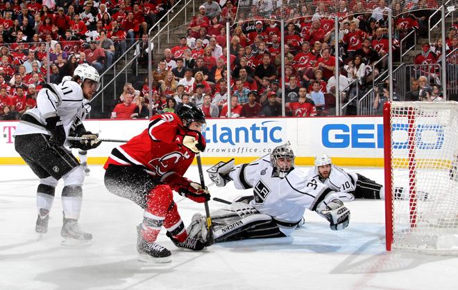 NEWARK, NJ - JUNE 02: Zach Parise #9 of the New Jersey Devils goes for the puck in front of Jonathan Quick #32 of the Los Angeles Kings as Anze Kopitar #11 and Mike Richards #10 look on during Game Two of the 2012 NHL Stanley Cup Final at the Prudential Center on June 2, 2012 in Newark, New Jersey.  (Photo by Bruce Bennett/Getty Images)