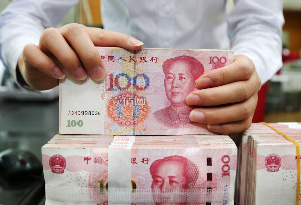 On the rise? An employee counts 100-yuan notes at a bank in Nantong in China's eastern Jiangsu province on July 23, 2018. Photo: AFP/Getty Images