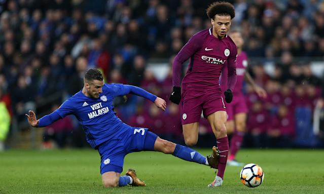 Leroy Sané's leg buckles under the late challenge of Cardiff left-back Joe Bennett.