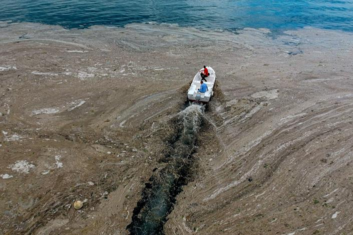 An aerial photograph taken on June 4, 2021, in Turkey's Marmara Sea at a harbor on the shoreline of Istanbul shows