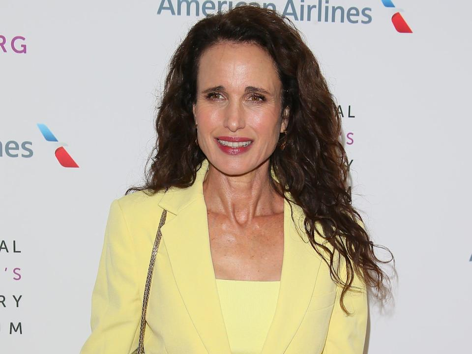 Andie MacDowell in a yellow suit