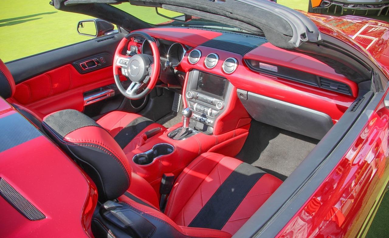 <p>Ditto inside, which is a sea of red lacquer and hand-stitched red leather wrapped around familiar Mustang componentry. The Speedster features two-piece seat backs rather than racing-style Recaros, though it does appear to use the same scrumptious, hand-stitched Italian leather and suede-like upholstery costs $21,000 extra on the coupe.</p>