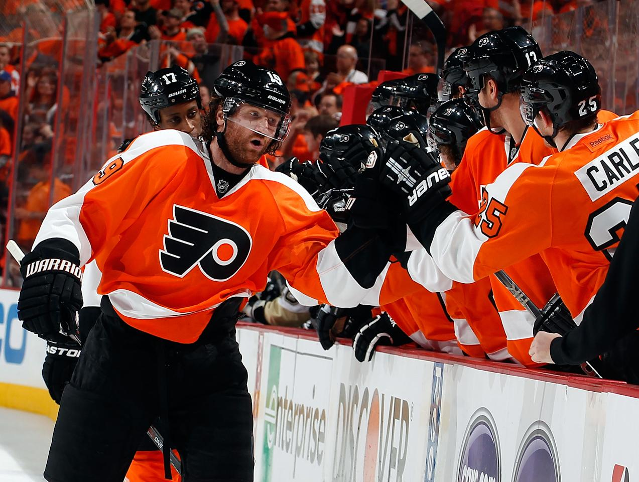 PHILADELPHIA, PA - APRIL 22:  Scott Hartnell #19 of the Philadelphia Flyers celebrates his goal with teammates at the bench in the first period of Game Six of the Eastern Conference Quarterfinals against the Pittsburgh Penguins during the 2012 NHL Stanley Cup Playoffs at Wells Fargo Center on April 22, 2012 in Philadelphia, Pennsylvania.  (Photo by Paul Bereswill/Getty Images)