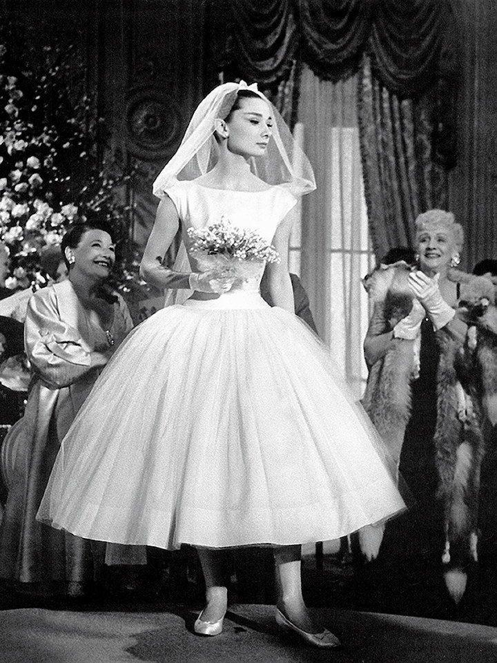 <p>Audrey Hepburn had many iconic movie looks, including this short satin-and-tulle Givenchy wedding dress. So. Freakin'. Chic. </p>
