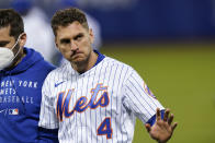 New York Mets' Albert Almora Jr. (4) gestures to fans after being injured during the eighth inning of the team's baseball game against the Baltimore Orioles on Tuesday, May 11, 2021, in New York. (AP Photo/Frank Franklin II)