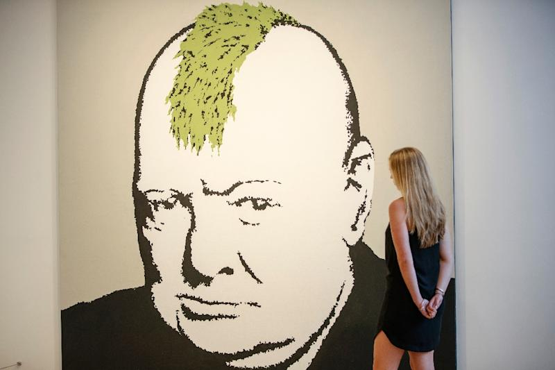 "Banksy's 2003 artwork ""Turf War"", which depicts Winston Churchill with a mohawk, at Lazinc Gallery in London (AFP Photo/Tolga AKMEN)"