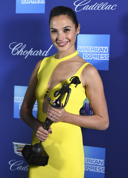 "Gal Gadot poses in the press room with the rising star award-actress for ""Wonder Woman"" at the 29th annual Palm Springs International Film Festival on Tuesday, Jan. 2, 2018, in Palm Springs, Calif. (Photo by Jordan Strauss/Invision/AP)"