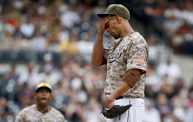 San Diego Padres starting pitcher Tyson Ross wipes his brow after surrendering a run to the Atlanta Braves in the seventh inning of a baseball game Sunday, Aug. 3, 2014, in San Diego. (AP Photo/Lenny Ignelzi)