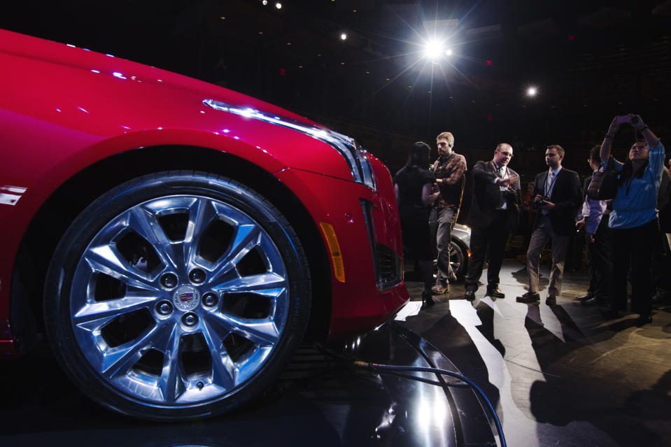 """A 2014 Cadillac CTS sedan is displayed on stage during an unveiling ceremony in New York, March 26, 2013. General Motors Co is turning to a redesigned, longer CTS mid-sized sedan to make its Cadillac luxury brand more competitive against German rivals. The new """"right-sized"""" CTS will debut this fall as a 2014 model, joining the smaller ATS and larger XTS sedans that the U.S. automaker introduced last year as part of a push to make Cadillac relevant far beyond its home market. REUTERS/Lucas Jackson (UNITED STATES - Tags: TRANSPORT BUSINESS)"""