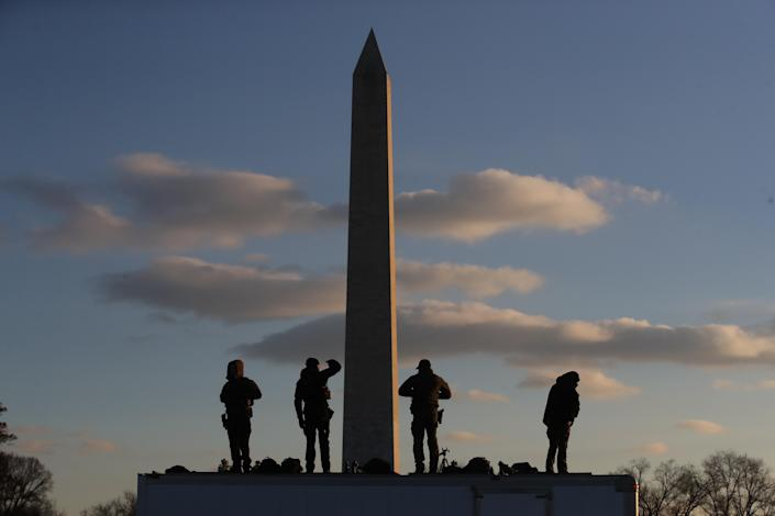 Members of the U.S. Secret Service stand guard atop a truck prior to the National Christmas Tree lighting ceremony near the White House on Wednesday in Washington. (Photo: Mark Wilson/Getty Images)
