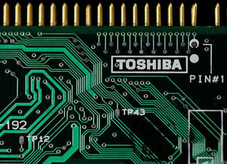FILE PHOTO: A logo of Toshiba is seen on a printed circuit board in this photo illustration taken in Tokyo