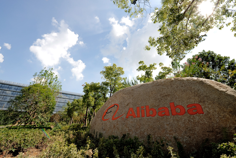 A rock outside of Alibaba headquarters with the Alibaba logo.
