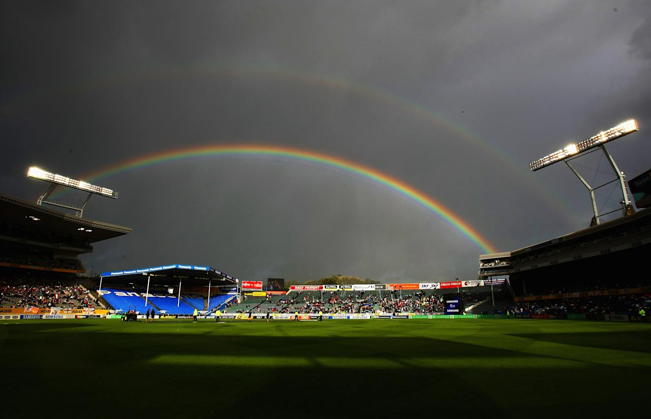 AUCKLAND, NEW ZEALAND - FEBRUARY 15:  A rainbow appears over the ground as play is stopped due to rain during the third National Bank series One Day International match between New Zealand and England at Eden Park on February 15, 2008 in Auckland, New Zealand.  (Photo by Clive Rose/Getty Images)