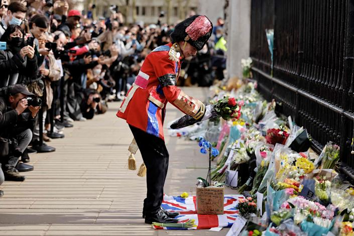 April 9, 2021: An ardent Royals fan lays a floral tribute at the front of Buckingham Palace in central London after the announcement of the death of Britain's Prince Philip, Duke of Edinburgh. Queen Elizabeth II's husband Prince Philip, who recently spent more than a month in hospital and underwent a heart procedure, died on April 9, 2021, Buckingham Palace announced. He was 99.