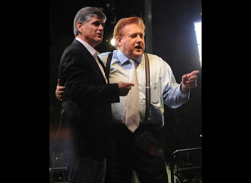 ATLANTA, GA - OCTOBER 06: Sean Hannity and Bob Beckel during the FOX News 'Hannity with Sean Hannity' 15th anniversary show at Olympic Centennial Park on October 6, 2011 in Atlanta, Georgia. (Photo by Chris McKay/Getty Images)