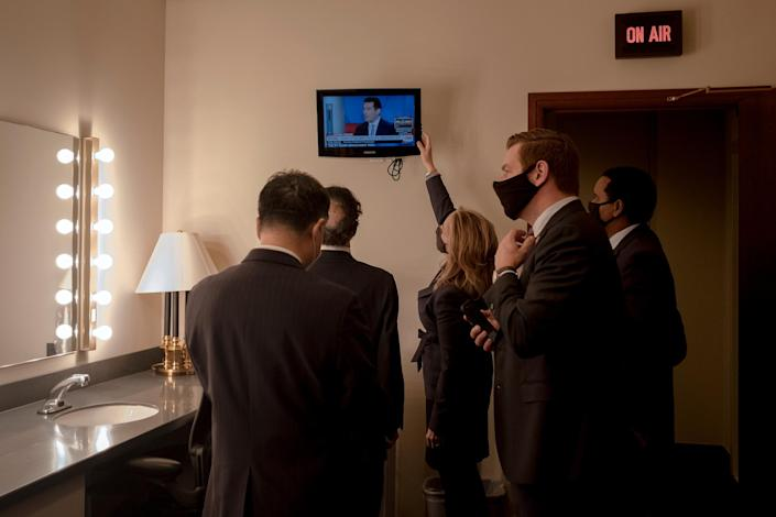 """House managers watch the news as they prepare to speak to the press on Feb. 13, 2021.<span class=""""copyright"""">Gabriella Demczuk for TIME</span>"""