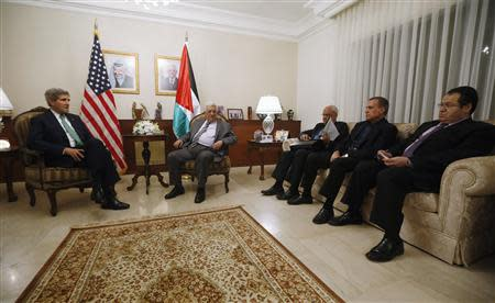 U.S. Secretary of State John Kerry (L) meets with Palestinian Authority President Mahmoud Abbas (2nd L) and members of his delegation in Amman, November 7, 2013. REUTERS/Jason Reed