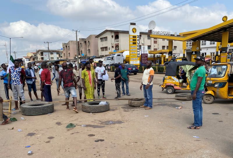 Demonstrators block a road during a protest demanding police reform in Lagos