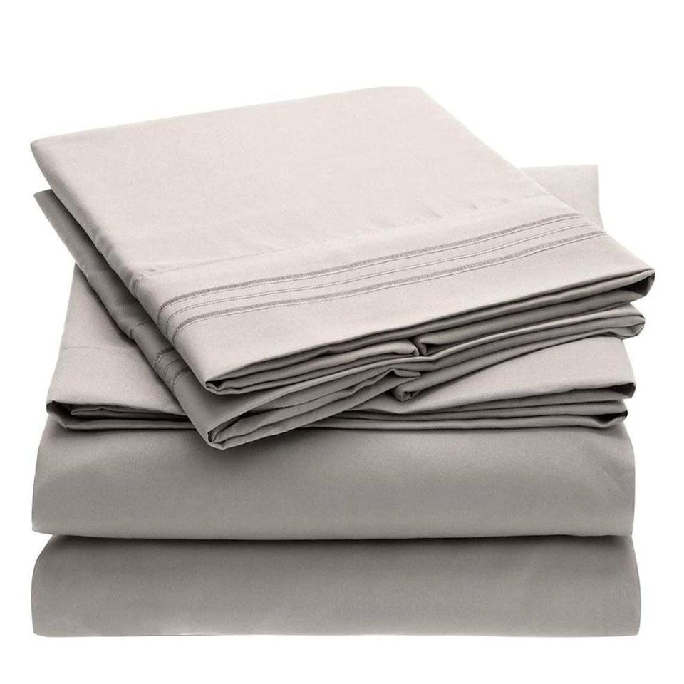 """<p><strong>Mellanni</strong></p><p>amazon.com</p><p><strong>$32.97</strong></p><p><a href=""""https://www.amazon.com/Mellanni-Bed-Sheet-Set-Hypoallergenic/dp/B00SBZJ8NG/?tag=syn-yahoo-20&ascsubtag=%5Bartid%7C2089.g.34579398%5Bsrc%7Cyahoo-us"""" rel=""""nofollow noopener"""" target=""""_blank"""" data-ylk=""""slk:Shop Now"""" class=""""link rapid-noclick-resp"""">Shop Now</a></p><p>With more than 150,000 reviews on Amazon, this bundle is clearly a favorite among anyone who sleeps. They're made from the highest quality brushed microfiber to provide you with the best sleep of your life. And there's actually a color option for anyone and everyone, from lilac and burgundy to white and silver. So, if you're looking for something cheap, of good quality, and universally loved, this might be it.</p>"""