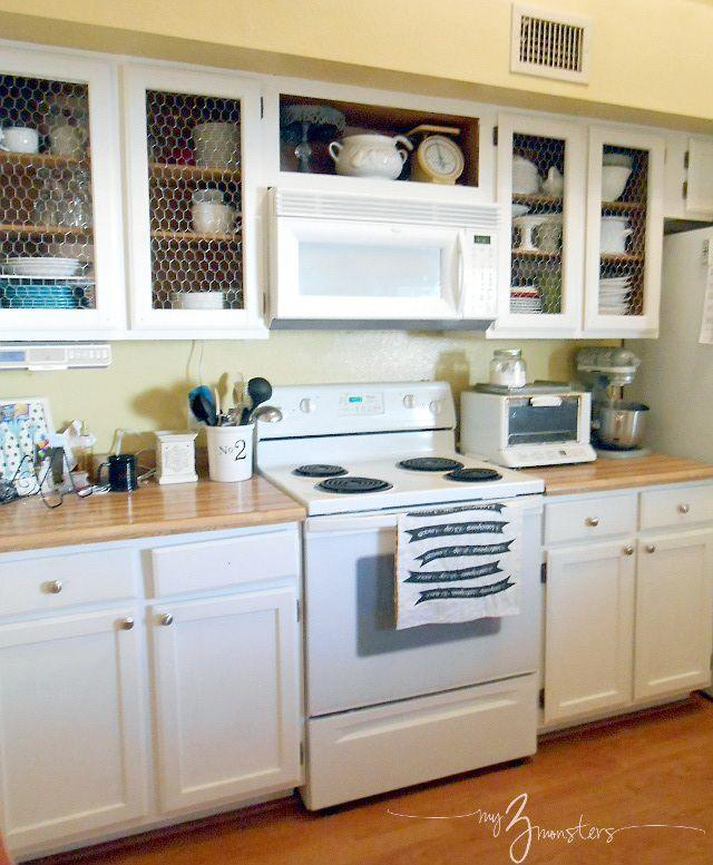 """<p>The blogger removed the recessed panels and added chicken wire for a rustic touch.</p><p><strong>Get the tutorial at <a href=""""http://www.my3monsters.com/2013/04/diy-kitchen-cabinet-makeover-with-chicken-wire.html"""" rel=""""nofollow noopener"""" target=""""_blank"""" data-ylk=""""slk:My3Monsters.com"""" class=""""link rapid-noclick-resp"""">My3Monsters.com</a>.</strong></p><p><strong><a class=""""link rapid-noclick-resp"""" href=""""https://www.amazon.com/s?k=chicken+wire&ref=a9_sc_1&tag=syn-yahoo-20&ascsubtag=%5Bartid%7C2139.g.34085615%5Bsrc%7Cyahoo-us"""" rel=""""nofollow noopener"""" target=""""_blank"""" data-ylk=""""slk:SHOP CHICKEN WIRE"""">SHOP CHICKEN WIRE</a><br></strong></p>"""