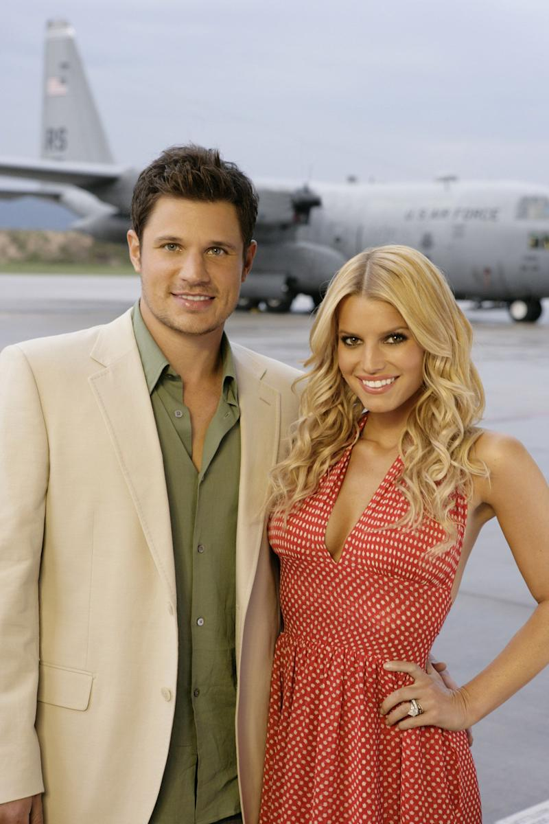 Nick Lachey and Jessica Simpson look amazing in this photo as they rock dinner clothes while posing for the camera.