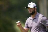 Jon Rahm, of Spain, reacts after putting on the fourth green during the third round of the BMW Championship golf tournament, Saturday, Aug. 28, 2021, at Caves Valley Golf Club in Owings Mills, Md. (AP Photo/Julio Cortez)
