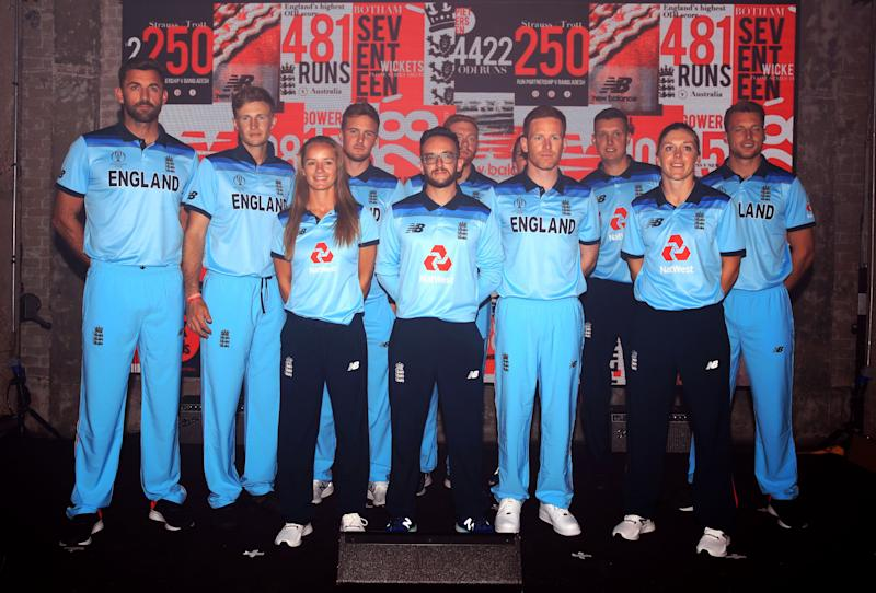 England captain Eoin Morgan (front row, second right) and women's captain Heather Knight (front row, right) alongside teammates during the New Balance England Kit unveiling in St Katherines and Wapping, London. (Photo by Adam Davy/PA Images via Getty Images)