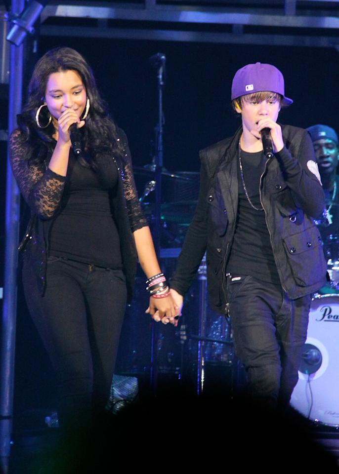 """Is Justin Bieber dating Jessica Jarrell, the opening act on his tour? After the singing sensation hugged and held hands with Jarrell onstage last week in Toronto, a number of websites began to ask if Bieber has a new girlfriend. To get the inside dish on the two, click over to <a href=""""http://www.gossipcop.com/justin-bieber-dating-dates-girlfriend-jessica-jarrell-holding-hands/"""" target=""""new"""">Gossip Cop.</a> Stephen Fernandez/<a href=""""http://www.splashnewsonline.com"""" target=""""new"""">Splash News</a> - August 21, 2010"""