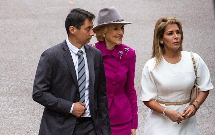 Princess Haya (right in white) seen for first time since fleeing Dubai as she arrives for High Court hearing - i-Images Picture Agency
