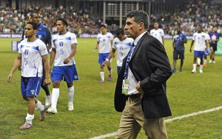 Honduras' coach Fernando Suarez and his team walk off the field after Mexico's overtime win in the CONCACAF Olympic qualifying finals soccer match in Kansas City