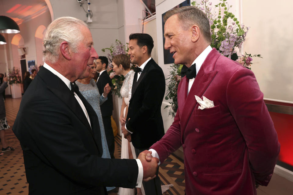Britain's Prince Charles, left, speaks to British actor Daniel Craig upon arrival for the World premiere of the new film from the James Bond franchise 'No Time To Die', in London, Tuesday, Sept. 28, 2021. (Chris Jackson/Pool Photo via AP)