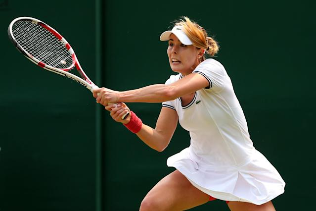 LONDON, ENGLAND - JUNE 26: Alize Cornet of France plays a backhand during her Ladies' Singles second round match against Su-Wei Hsieh of Taipei on day three of the Wimbledon Lawn Tennis Championships at the All England Lawn Tennis and Croquet Club on June 26, 2013 in London, England. (Photo by Julian Finney/Getty Images)