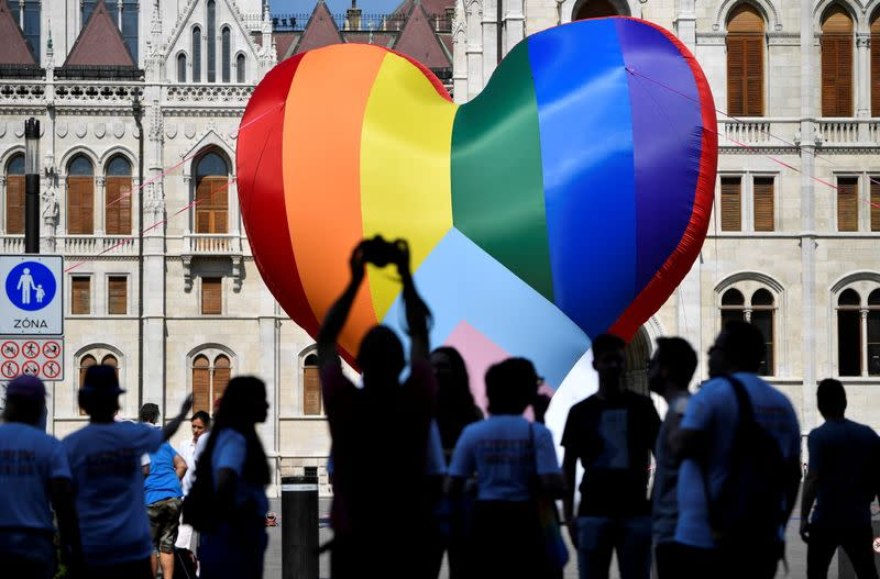 FILE PHOTO: NGOs put up a huge rainbow balloon at Hungary's parliament protesting against anti-LGBT law in Budapest